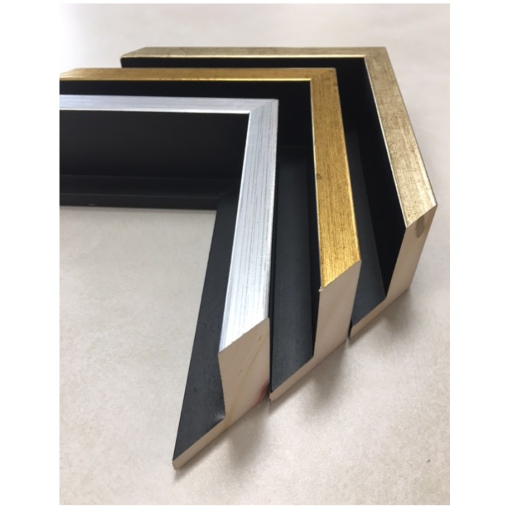 tall black float frame with foil on top